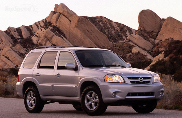 2006 Mazda Tribute - front three-quarter view, with boulders