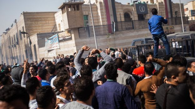 Mourners protest the death of Mohamed Ali, a 23 year-old driver, who was shot dead overnight during a dispute with a police sergeant, outside local security headquarters in Cairo, Egypt, Friday, Feb. 19, 2016.