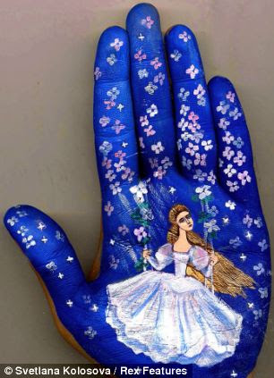 Living art: Svetlana Kolosova chose to paint on her palm because she fells it adds a living aspect to her work which a static canvass would not