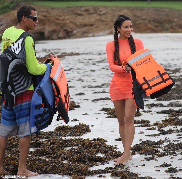 Mom's day off: Kim Kardashian made it a girls' day on Thursday as she headed down to the beach in Punta Mita, Mexico with pals