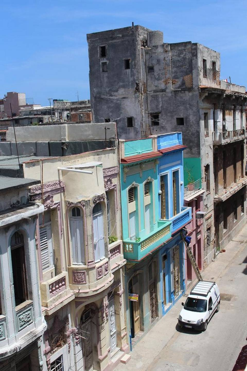 Fresh paint on residential buildings in Havana is often a sign that the homes are being renovated and prepared for rentals.