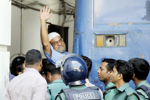 DHAKA: File photo shows Bangladeshi Jamaat-e-Islami party leader, Mir Quasem Ali waving as he enters a van at the International Crimes Tribunal court in Dhaka. A wealthy tycoon who was a chief financier for Bangladesh's largest Islamist party could be executed in days after losing his final appeal yesterday, against a death sentence from a controversial war crimes tribunal. — AFP