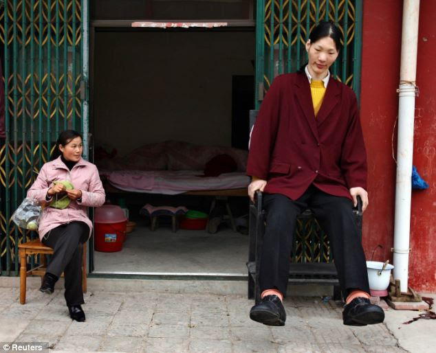 Yao Defen and her friend sit at the entrance of her home in Shu Cha in eastern China's Anhui province in 2006