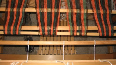 Getting the warp ready to transfer to the apron rod.