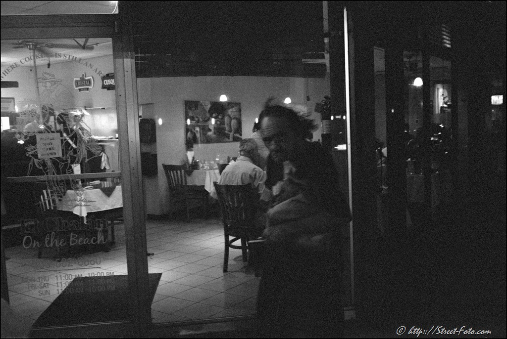 Homeless man leaving a caffe at Washington Avenue in Miami Beach, Florida, USA, 2011. Street Photography of Miami, San Francisco and Key West by Emir Shabashvili, see http://street-foto.com, http://miamistreetphoto.com, http://miamistreetphotography.com or http://miamistreetphotographer.com