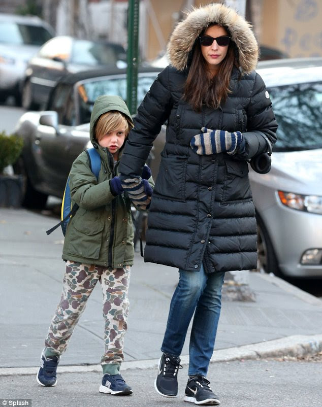 Bundled up: Liv Tyler and her son Milo were wrapped up very warm when they stepped out in New York on Tuesday