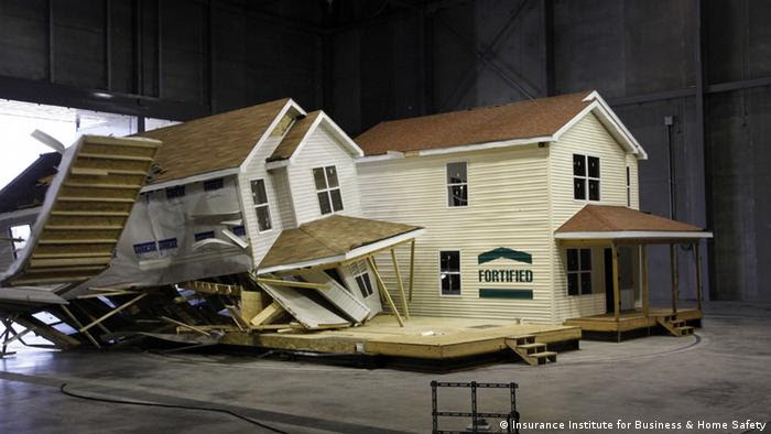 A wrecked house sits inside of a wind tunnel. (Photo: http://ofb.ibhs.org/media/images/gallery?imageGalleryId=4570#dialog=