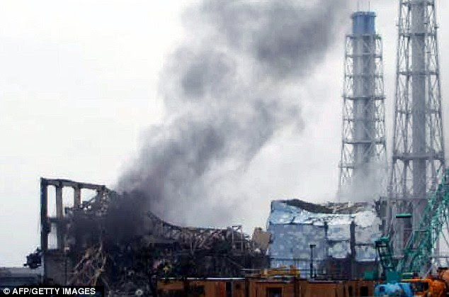 Panic: Smoke rises from the shell of reactor No 3 at Fukushima. Emails from the U.S. Nuclear Regulatory Commission reveal experts were kept in the dark about the scale of the disaster
