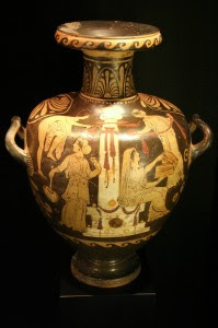 The image on the right half of this vase depicts Pandora opening her infamous jar.