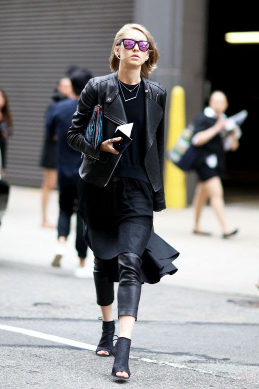 Le Fashion Blog Street Style Nyfw All Black Layered Spring Look Mirrored Sunglasses Moto Jacket Sweater Colorful Print Clutch Flared Hem Skirt Cropped Leather Pants Open Toe Booties Via Refinery29