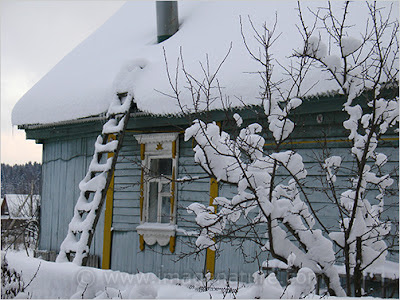 Traditional Russian house under snow