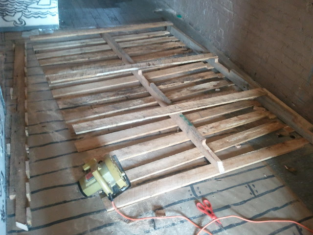 Ho'made recycled pallet slat wall stage one