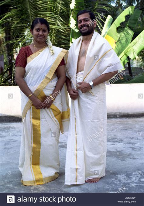 A COUPLE IN TRADITIONAL KERALA DRESS Stock Photo: 12400682