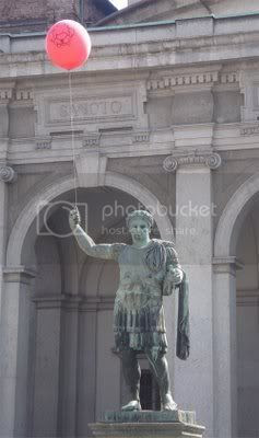 statue with balloon