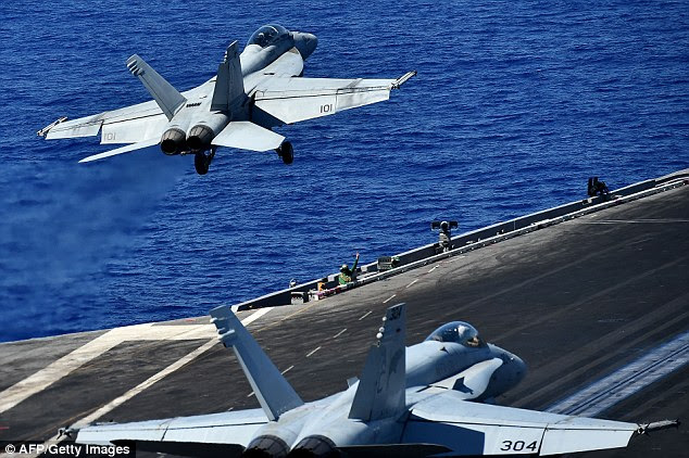 US Air Force Col. John Dorrian, a coalition spokesman, spoke out almost immediately against the Russian claim - dubbing it propaganda. Pictured are American jets on an aircraft carrier in July 2016