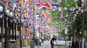Preparations are made for a Jubilee street party in Canal Street in Manchester, England