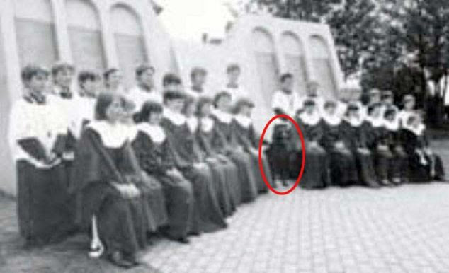 Is there a ghost of a chance? This apparition of a labrador which appears between the two banks of choristers is one of the photos that are said to be of the dog's Dambusters spirit