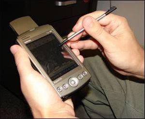 English: A handheld computer with GPS and GIS ...