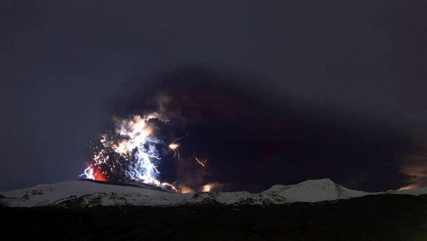 Lightning envelops a plume of ash that comes out of the Eyjafjallajokull volcano in Iceland, on April 18, 2010.