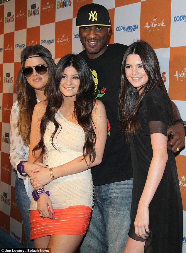 Troubling times: Kendall Jenner, far right, is pictured with former brother-in-law Lamar Odomm, second right, and sisters Kylie Jenner, second left, and Khloe Kardashian, far left, in  October 2015. Lamar is currently struggling in a coma