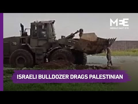 Watch ... the Israeli bulldozer drags the body of a martyr in the southern Gaza Strip