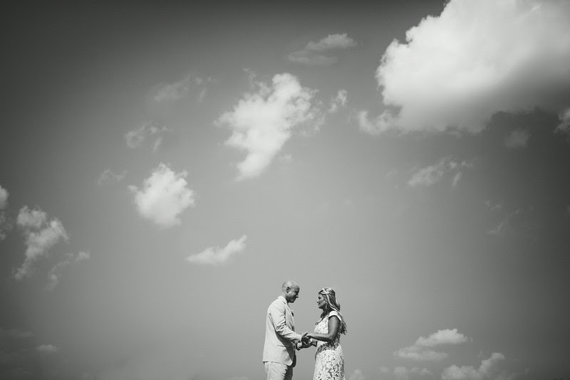 Photo of a bride and groom against a skyline / horizon line following a small backyard wedding ceremony in Rockford IL. Photo by Mindy Joy Photography