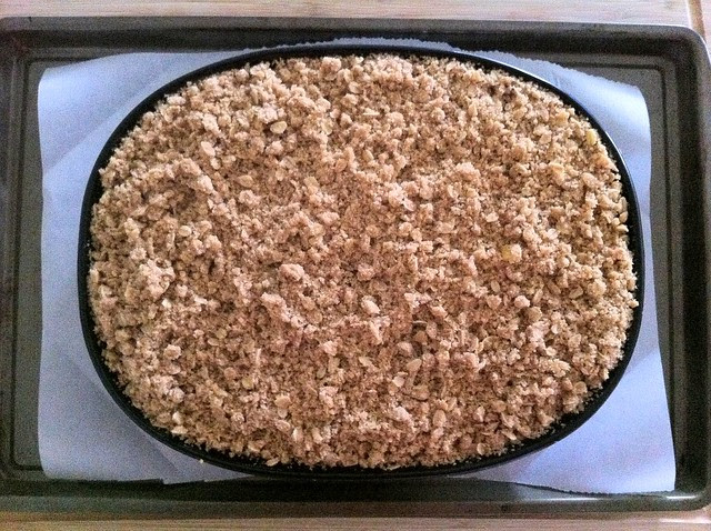 Apple Crumble Added to Lined Baking Sheet