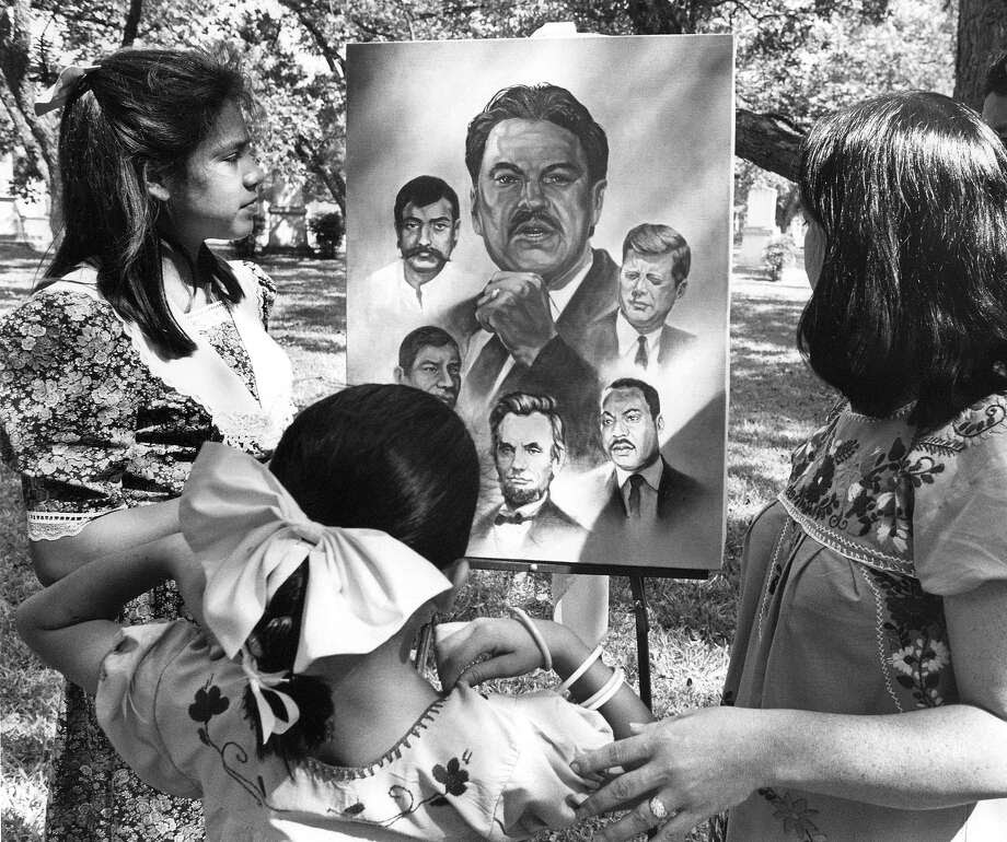 Catarina Velásquez admires a painting of her  father, Southwest Voter Registration Project founder Willie Velasquez, in 1988, four months after his death. Photo: File Photo