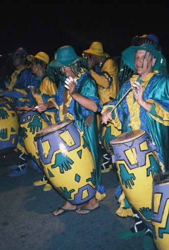 The drummers pass by the camera