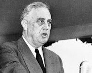 """FILE - In this April 13, 1943 black-and-white file photo, President Franklin Delano Roosevelt speaks in Washington. When President Barack Obama's re-election campaign unveiled a new slogan, some conservative critics were quick to pounce. """"Forward"""", they asserted, is a word long associated with Europe's radical left, reaffirming their contention that Obama is, to some degree a socialist. Using """"socialist"""" as a political epithet in the U.S. dates back to pre-Civil War days when abolitionist newspaper editor Horace Greeley was branded a socialist by some pro-slavery adversaries. Decades later, many elements of Franklin Roosevelt's New Deal _ including Social Security _ were denounced as socialist. (AP Photo/Robert Clover, File)"""