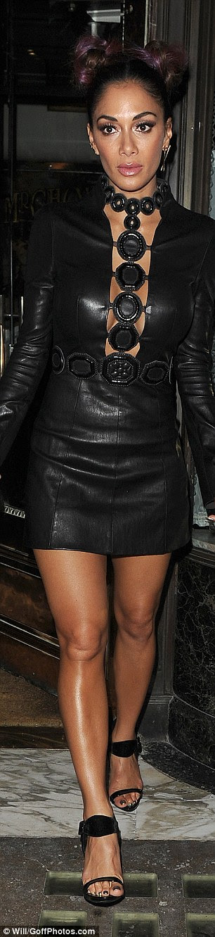 Leggy display: The singer displayed her enviable physique in the skin tight dress which teased a glimpse of her cleavage and boasted a collar