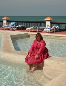 Kim enjoying the pool water in Mexico during a study trip for one of her books.