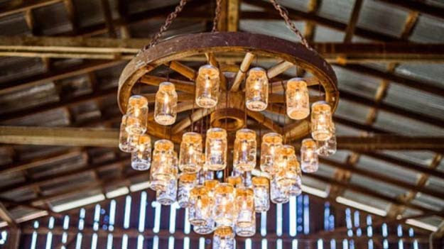 DIY Lighting Ideas and Cool DIY Light Projects for the Home. Chandeliers, lamps, awesome pendants and creative hanging fixtures,  complete with tutorials with instructions | Wagon Wheel Mason Jar Chandelier | http://diyjoy.com/diy-projects-lighting-ideas