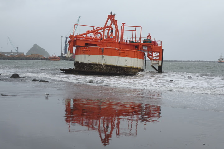 This NZ Steel sand extractor washed up on Ngamotu Beach, Port Taranaki, New Plymouth.