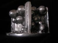 Aluminum Sculpture - side view of negative space for cat eye boulder, no color filter