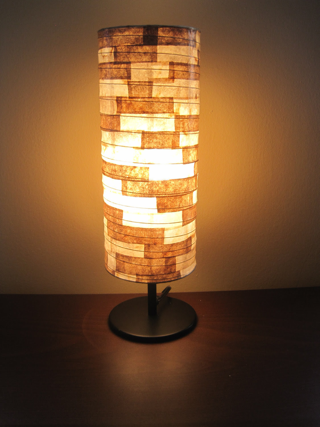best and favorable unusual table lamp design in tube style in golden light on wooden table