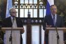 U.N.-Arab League peace mediator Brahimi and Russia's Foreign Minister Lavrov attend a joint news conference in Moscow
