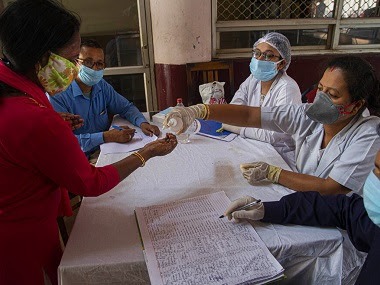 India's total number of coronavirus positive cases rose to 28,380. AP