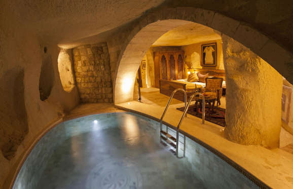 The views of the inside are pretty great too, as you can take a dip in a little cave pool, which is all part of the luxury spa facilities on site.