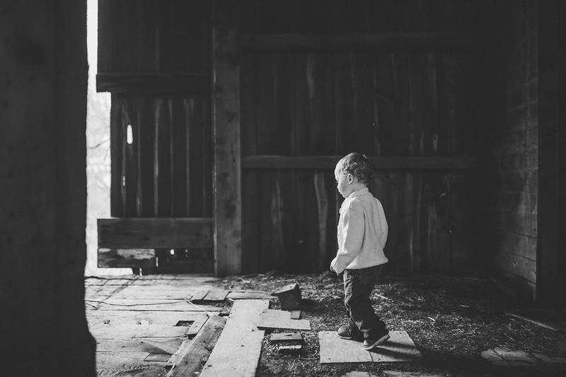 Outdoor winter/fall family portraits at Rock Cut State Park and an old rustic country barn. Kylie and Evan and their son had a variety of candid playful moments and a few maternity photos as well.