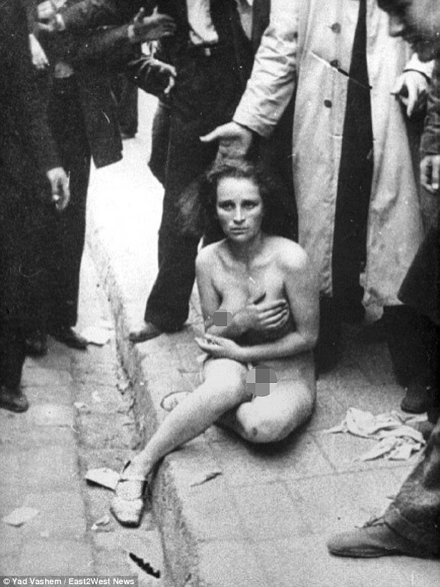 "Cruelty: The Nazis mowed people down in a ""Holocaust of Bullets"" and also subjected Jews to horrendous public humiliation by forcing them to strip in the streets (pictured) before beating them"