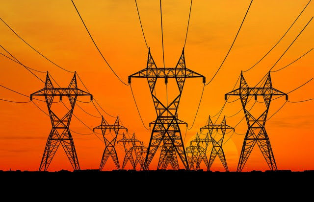 Power line pylons, at sunset