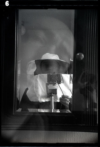 reflected self-portrait with Baldi camera and beekeeping hat and veil by pho-Tony