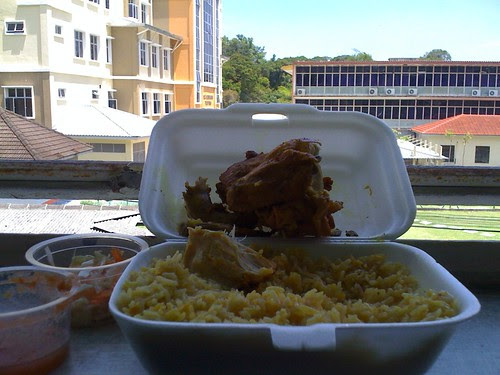 Enjoying my nasi mandy near window