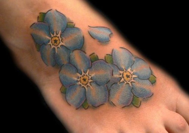 Blue Daisy Flowers Tattoo Design On Foot Tattoos Book 65000