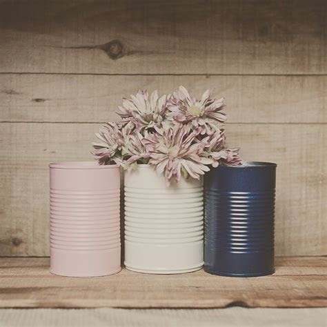 3 painted tin cans. Pink and navy blue, blush pink