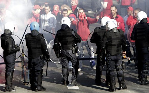 Riot police attack protesters outside the European Union summit in Brussels. The western European states are facing continued economic crises and are imposing austerity measures on the working people of the region. by Pan-African News Wire File Photos