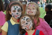 Three girls with faces painted as animals
