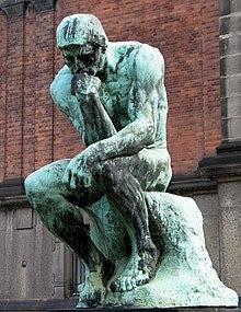 El pensador, de Auguste Rodin, representación clásica de un hombre inmerso en sus pensamientos.