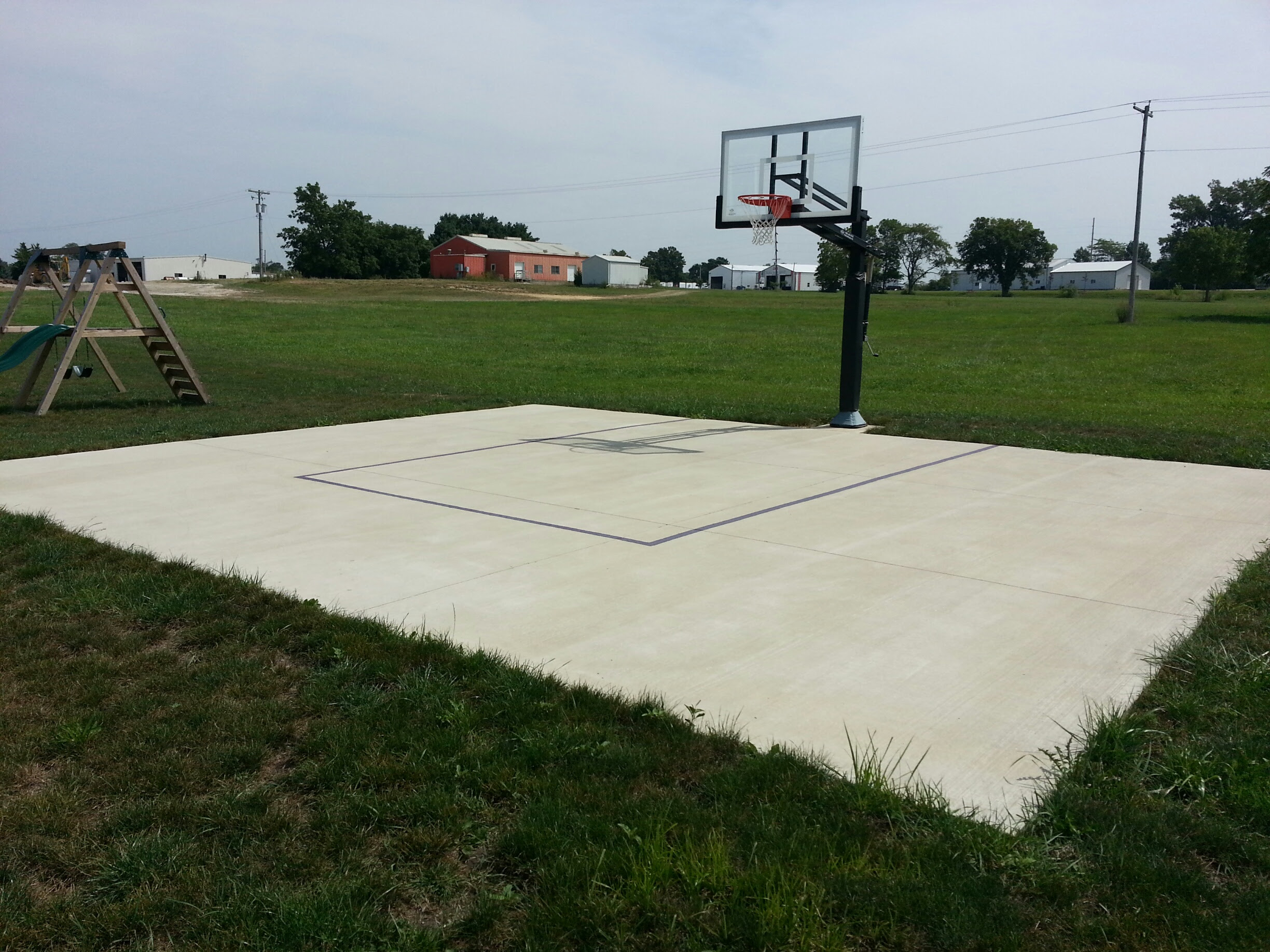 The Pro Dunk Gold Sits Center On A Dedicated Concrete Slab Measuring